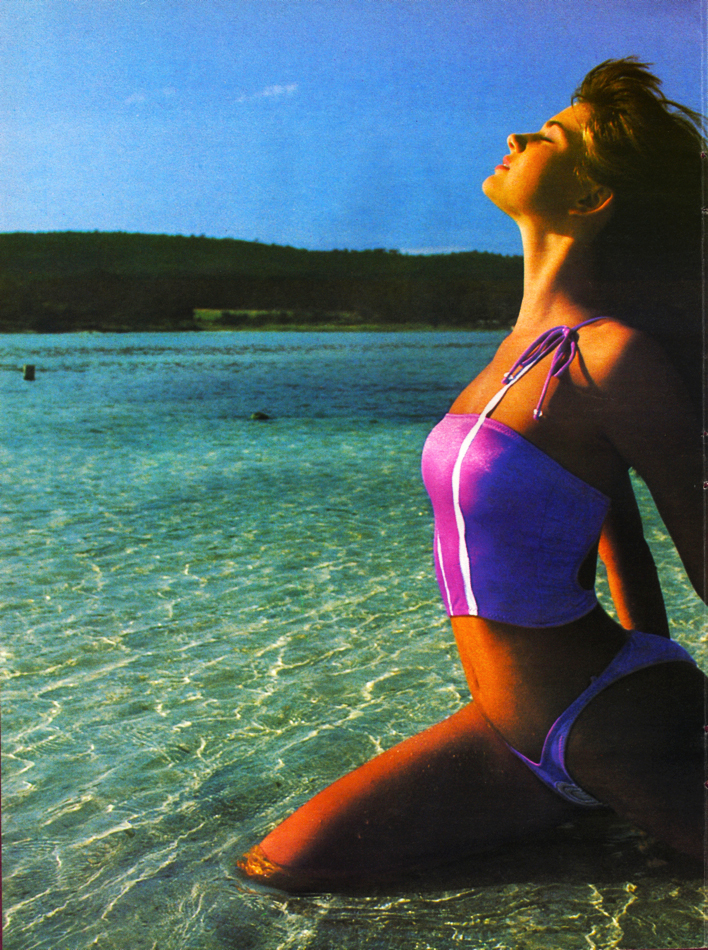 Girl at Beach Pink Swimsuit Breathing